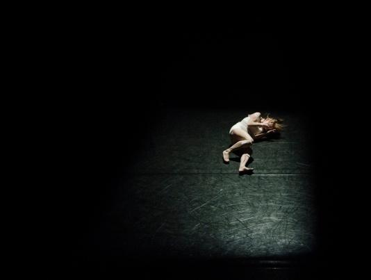 hailey-keen-unsplash-woman-on-floor-in-agony