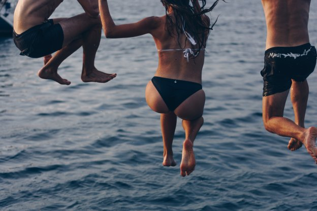 angelo-pantazis-unsplash-people jumping in water